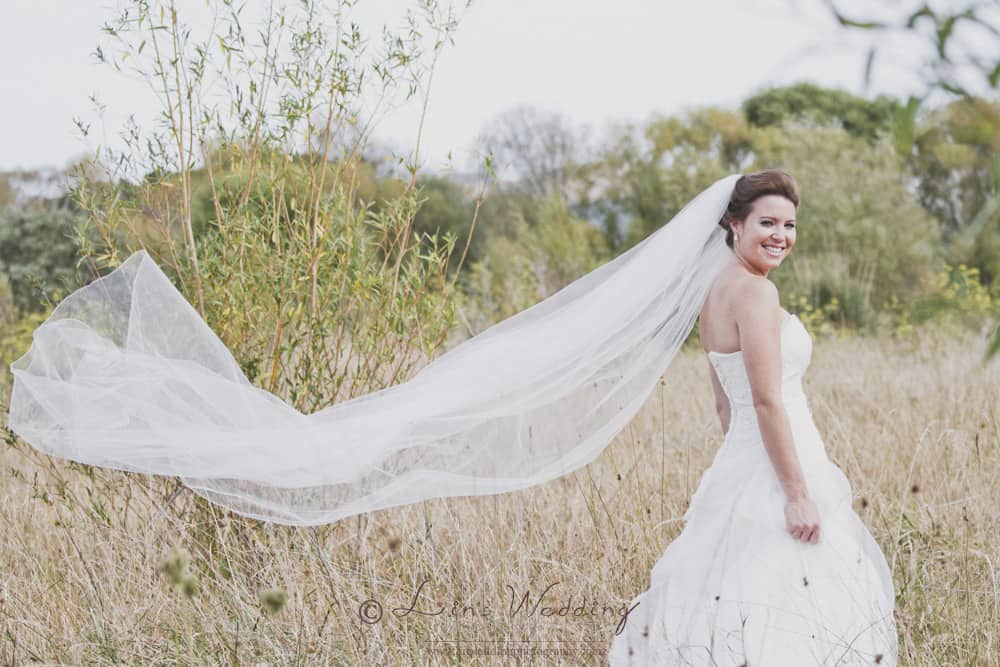 A beautifu flow veil to go with the stunning wedding dress by Lin Wedding Photography